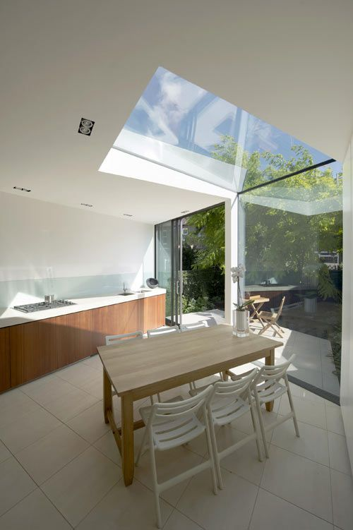 Kitchen extension ideas that spill into the outdoors with galss