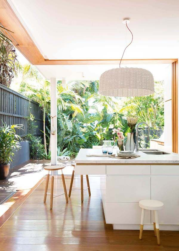 Kitchen extension ideas that spill into the outdoors glass walls